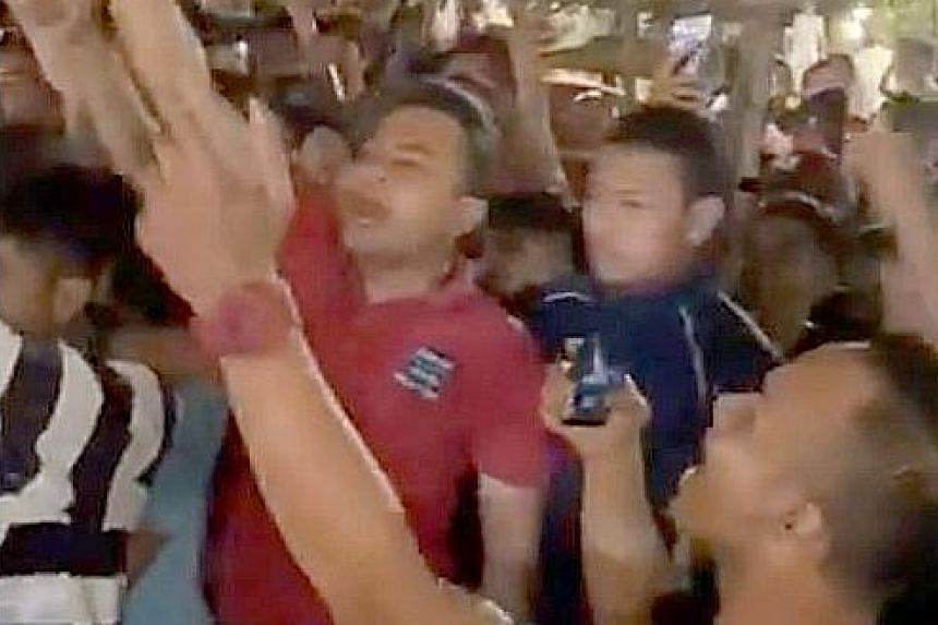 A screengrab of a video showing dozens of young men whom Malaysia's Youth and Sports Minister Syed Saddiq Syed Abdul Rahman said gatecrashed and interrupted his political party's event last Friday night. PHOTO: TEAMSADDIQ/ TWITTER