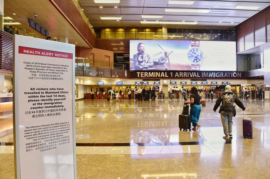 A Health Alert Notice placed near the Changi Airport Terminal 1 Arrival hall on Feb 2, 2020.