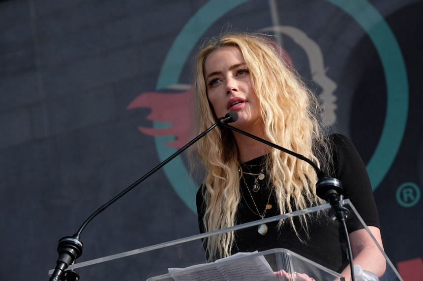 Amber Heard (above) is heard talking to Johnny Depp, then her husband, about their strained relationship, admitting that she hit him, and had previously threw pots and pans.
