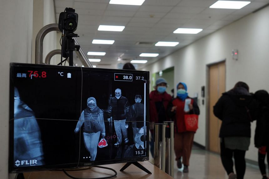 A thermal scanner monitoring people's body temperatures in a hospital in Taipei, on Feb 1, 2020.