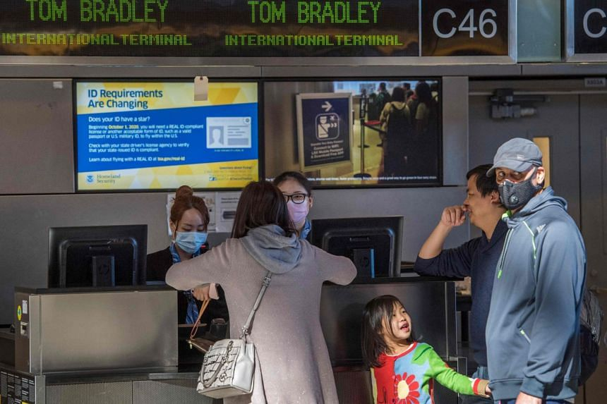 Passengers making inquiries at a counter at the Los Angeles International Airport as flights continue to be cancelled due to fears of the coronavirus, on Feb 1, 2020.
