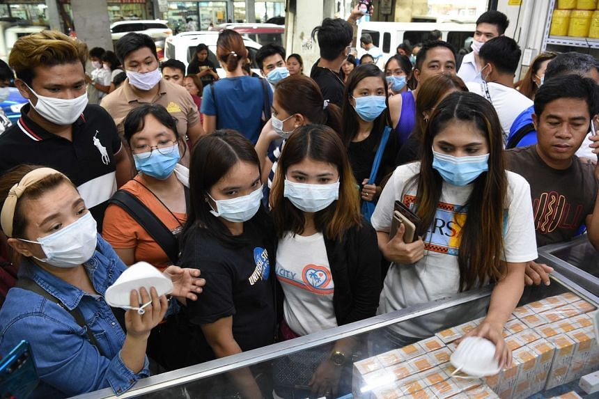 People buying protective masks at a medical supplies store in Manila on Jan 31, 2020.