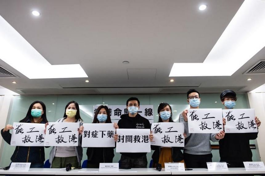 Representatives from various unions hold slogans during a press conference on the latest update of the strike actions in Hong Kong on Feb 2, 2020.