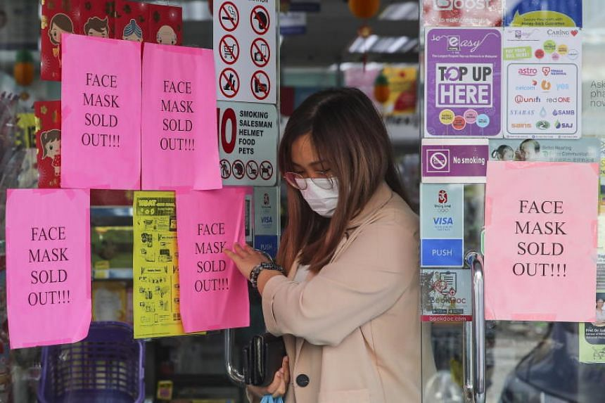 A woman leaving a pharmacy in Kuala Lumpur, Malaysia, on Jan 30, 2020. Police have arrested six people for spreading misinformation about the novel coronavirus, a Malaysian Communications and Multimedia statement said.