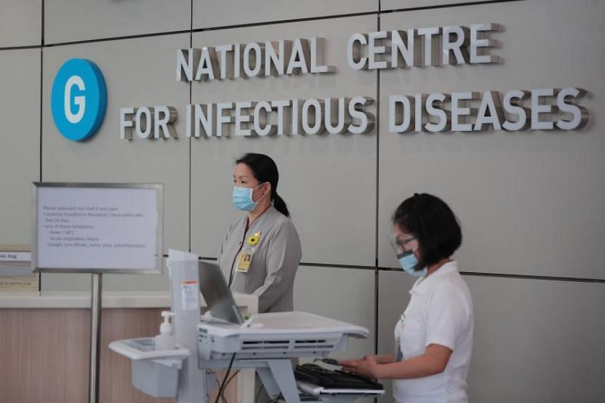 Staff at the National Centre for Infectious Diseases on Jan 31, 2020.