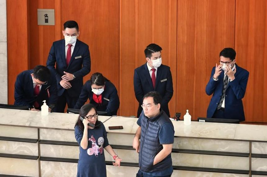 Hotel staff wearing masks as they attend to hotel guests on Jan 28, 2020.