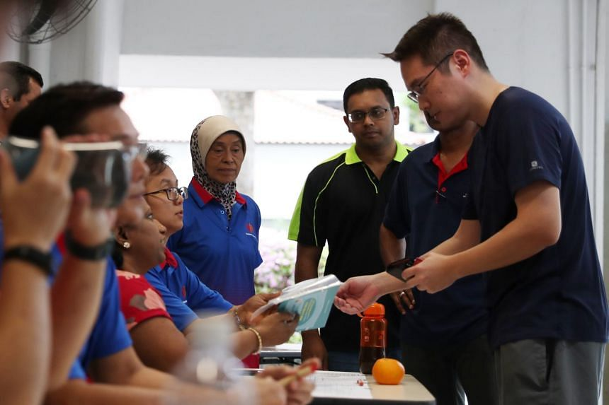 A resident collects masks from the collection counters at the residents' committee centre at Block 47 Telok Blangah Drive on Feb 2, 2020.