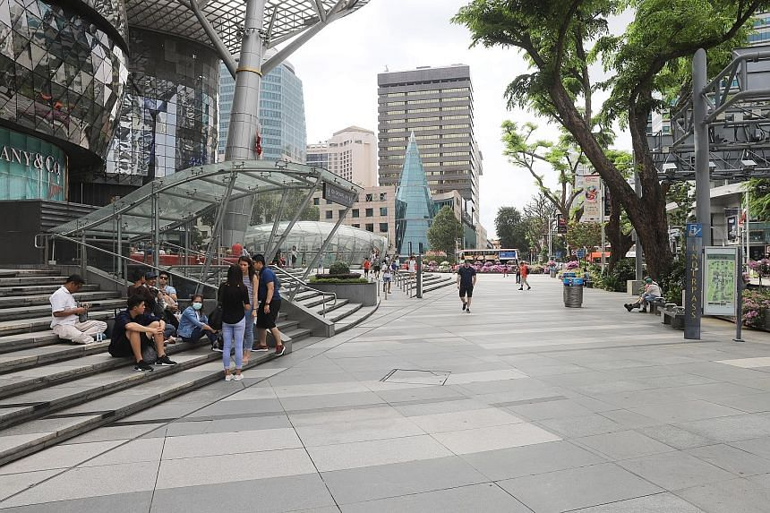Orchard Road was visibly quieter yesterday, as some appeared to shy away from crowded areas, while those out and about said they enjoyed the relief from weekend crowds. ST PHOTO: MARCELLIN LOPEZ