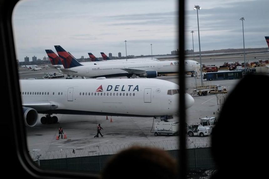 Delta airplanes sit on the tarmac at John F. Kennedy Airport (JFK) on Jan 31, 2020 in New York City.