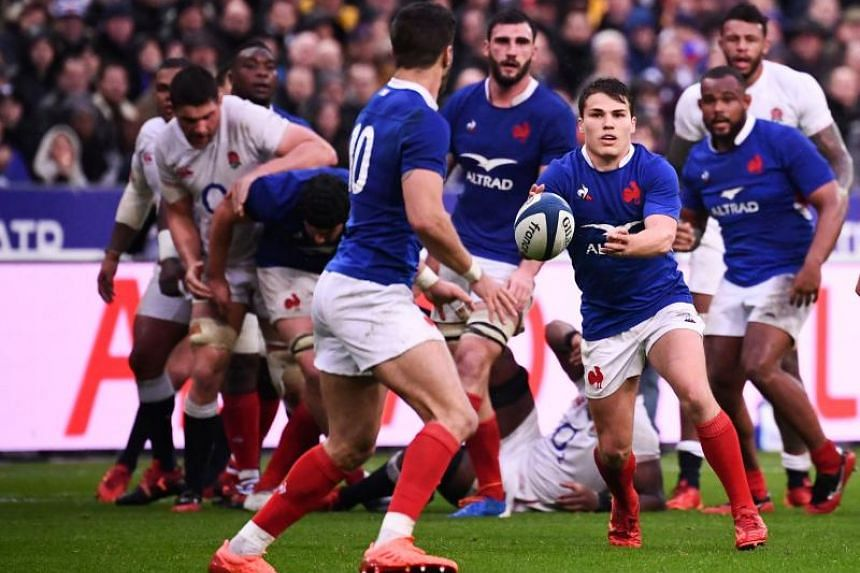 France's scrum-half Antoine Dupont (right) passes the ball during the Six Nations rugby union tournament match against England at the Stade de France, in Saint Denis, on Feb 2, 2020.