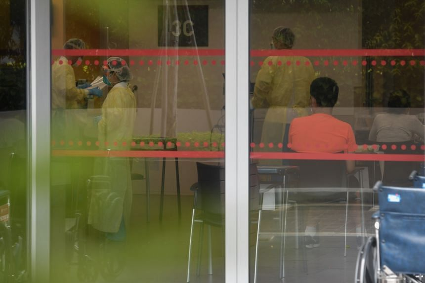 A photo taken on Jan 30, 2020, shows a person being screened at the National Centre for Infectious Diseases.