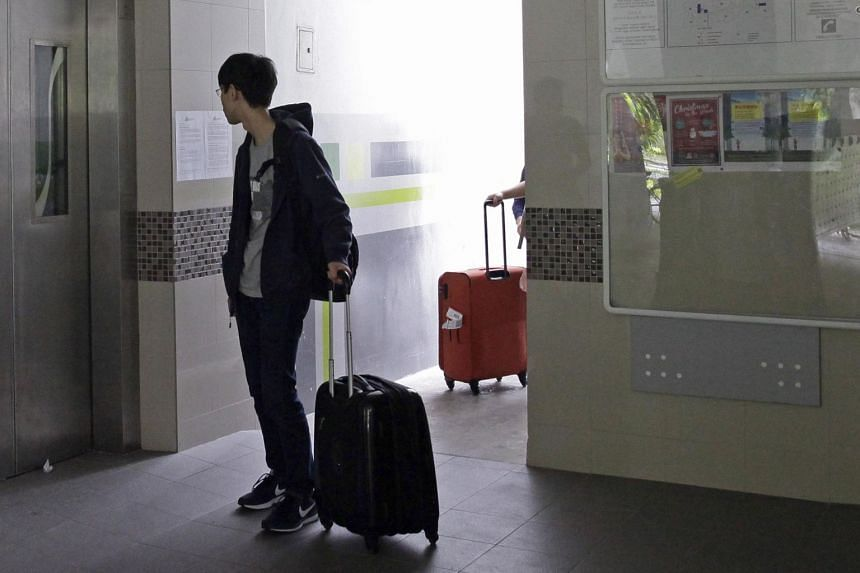 In a photo taken on Dec 27, 2013, a man with his luggage waits for a lift. Landlords found to have irresponsibly evicted residents on Leave of Absence or quarantine may face restrictions, be barred from renting out flats.