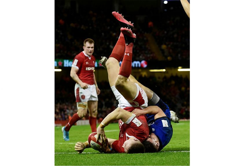 Grand Slam champions Wales' Josh Adams scoring their fifth try to complete his hat-trick in their 42-0 trouncing of Italy at Cardiff's Principality Stadium on Saturday. It was a feat not seen since Maurice Richards' four tries against England in 1969.