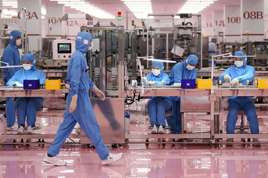 Workers at the inauguration of a new production plant for Japanese cosmetics brand Shiseido in Japan on Nov 27, 2019.