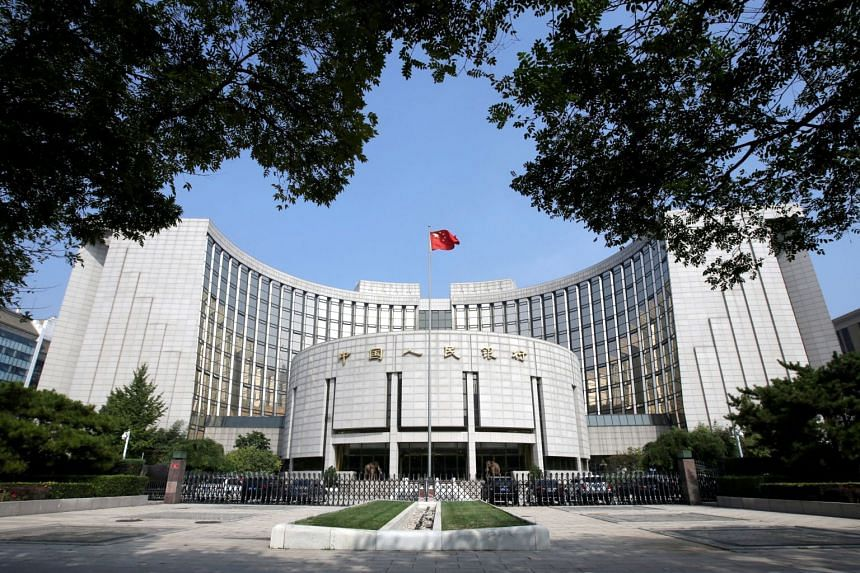 The People's Bank of China said on it was lowering the seven-day reverse repo rate to 2.40 per cent from 2.50 per cent.
