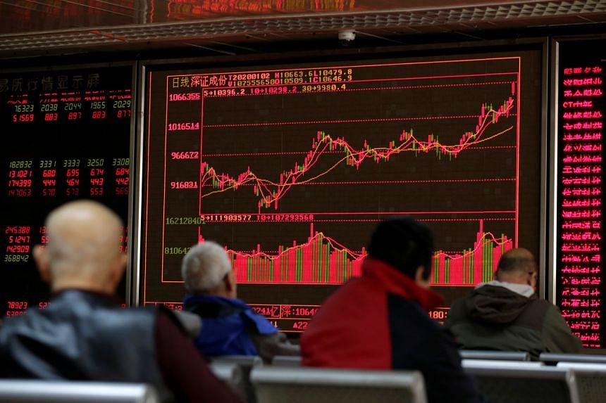 In this picture taken on Jan 2, 2020, stock information is seen at a brokerage office in Beijing. On Feb 3, the benchmark Shanghai Composite Index dived 8.73 per cent while the Shenzhen Composite Index sank 8.99 per cent.