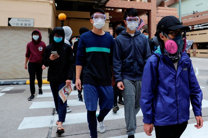 Residents march to protest against the government's plan to set up a quarantine site near their community amid the Wuhan virus outbreak in Hong Kong, on Feb 2, 2020.