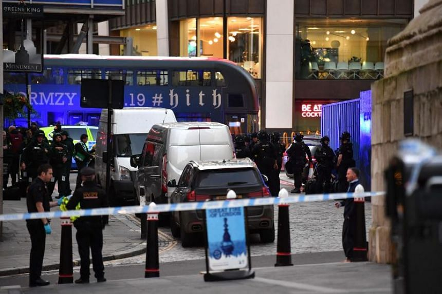 Police gather near at a street in central London after a terror attack on London Bridge on Nov 29, 2019.