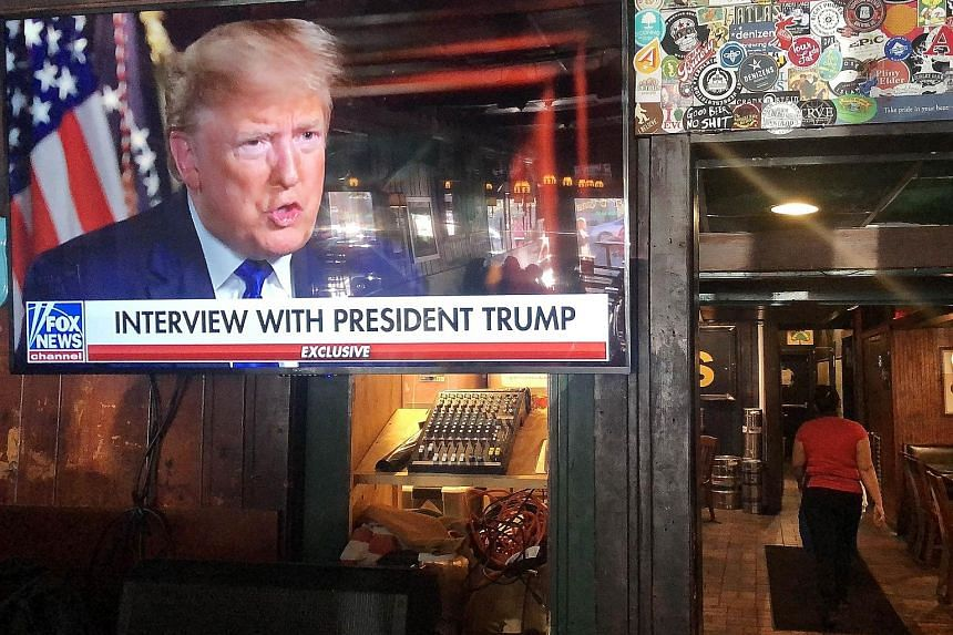 President Donald Trump's interview with Fox News was broadcast on Sunday, ahead of the Senate's expected vote tomorrow to acquit him of impeachment charges. PHOTO: AGENCE FRANCE-PRESSE