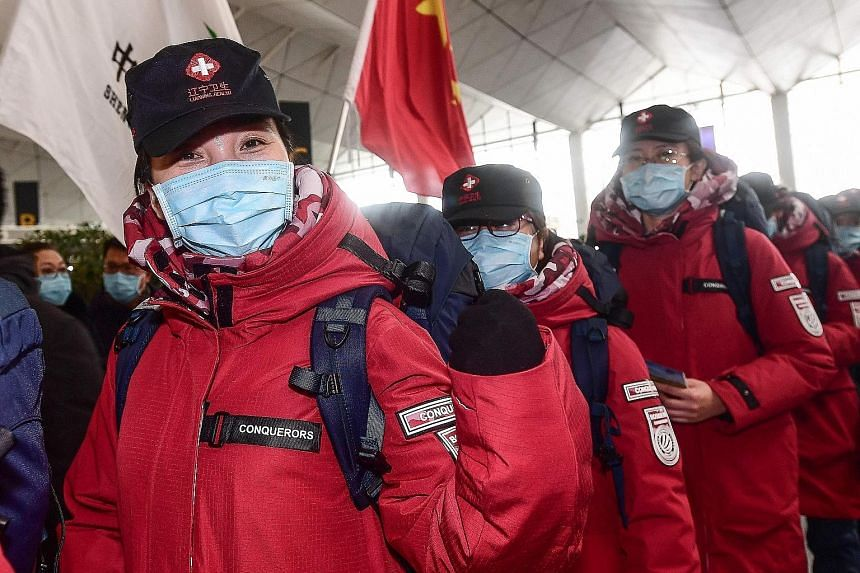 Medical workers from Shenyang, in China's Liaoning province, heading for Wuhan, the epicentre of the coronavirus outbreak, at the Xiantao International Airport on Sunday. Yesterday, the death toll in China hit 361, exceeding the 349 killed in mainlan