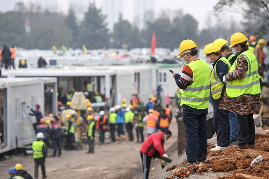 Workers at a construction site of the Huoshenshan hospital in China's central Hubei province, on Feb 2, 2020.