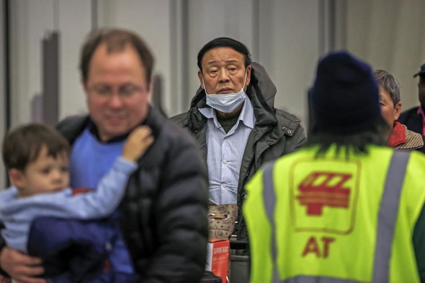 In a photo taken on Jan 24, 2020, passengers exit customs and screening areas as they arrive at O'Hare International Airport in Chicago.