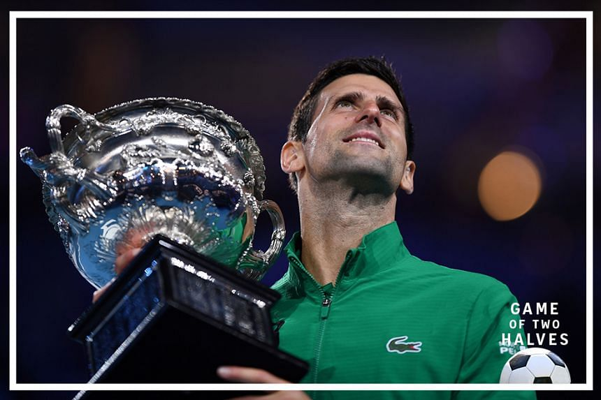 Serbia's Novak Djokovic holds the Norman Brookes Challenge Cup trophy after beating Austria's Dominic Thiem in their men's singles final on the final day of the Australian Open tennis tournament in Melbourne on Feb 3, 2020.