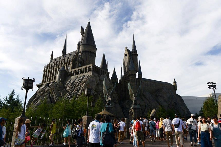 Visitors at the Universal Studios in Osaka. Warner Bros. Entertainment, Inc., plans to open a Harry Potter theme park in Tokyo by the spring of 2023.
