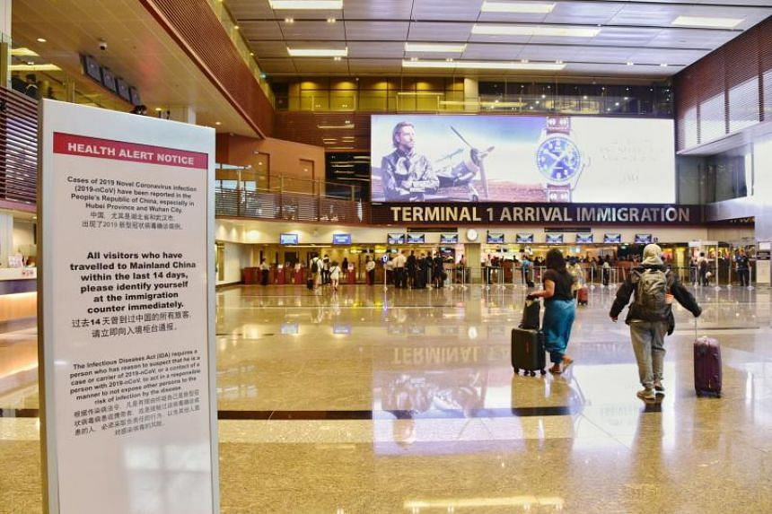 A Health Alert Notice is placed near the Changi Airport T1 Arrival Immigration on Feb 2, 2020.