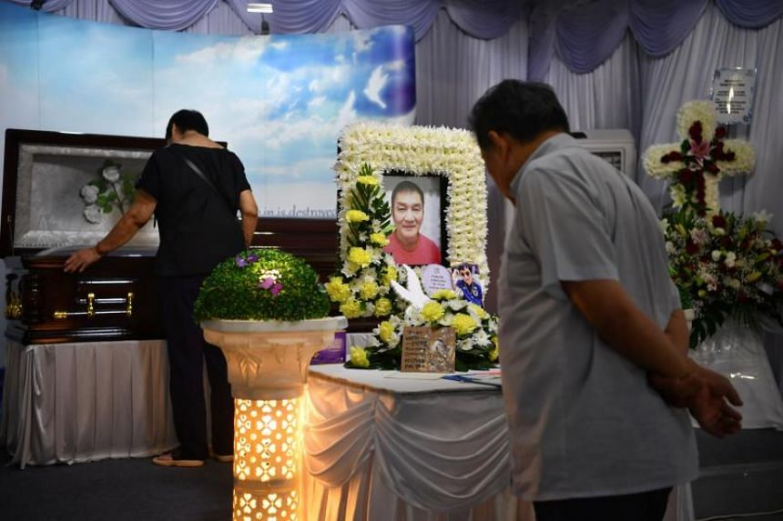 People pay their respects at the wake of the late Pastor Philip Chan at The Hiding Place on Feb 4, 2020.