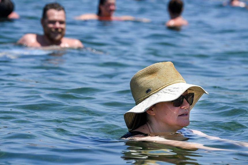Swimmers take a dip at Mahon Pool, Maroubra, south of Sydney, Australia, Jan 31, 2020.