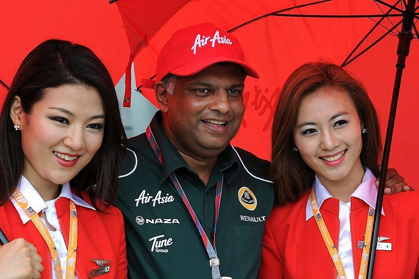 Mr Tony Fernandes, seen in a 2011 file photo, was one of Airbus' most loyal customers. He will leave his role as AirAsia chief executive for two months while the government probes corruption allegations, according to a statement on Monday.