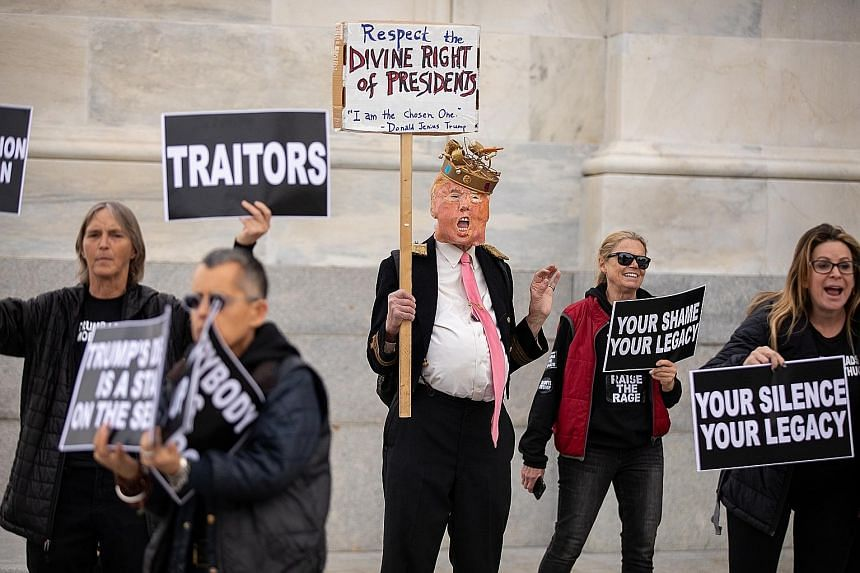 Demonstrators on both sides of the political divide outside the US Capitol on Monday, with one man dressed as President Donald Trump.