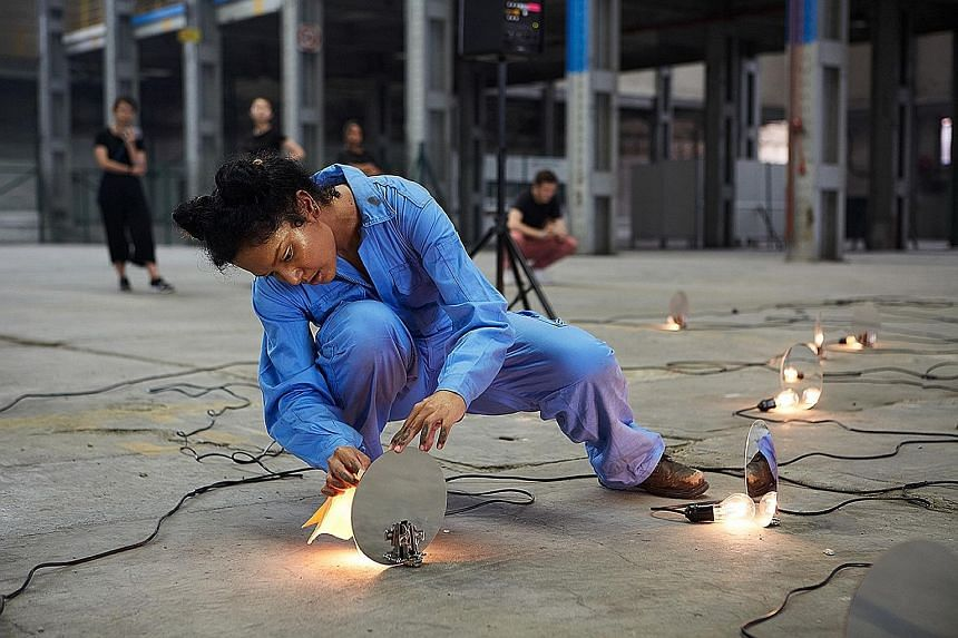 Modern Resonance II is a site-specific work staged by sound artist Li-Chuan Chong, spoken word poet Deborah Emmanuel (left) and visual artist Alecia Neo