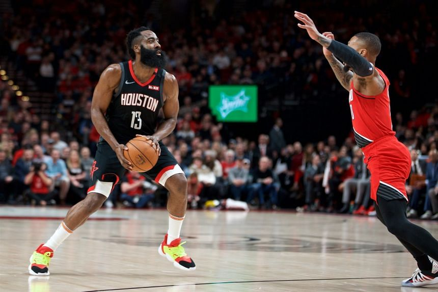 Houston Rockets guard James Harden (13) steps back against Portland Trail Blazers guard Damian Lillard (0) during the first quarter at the Moda Center.