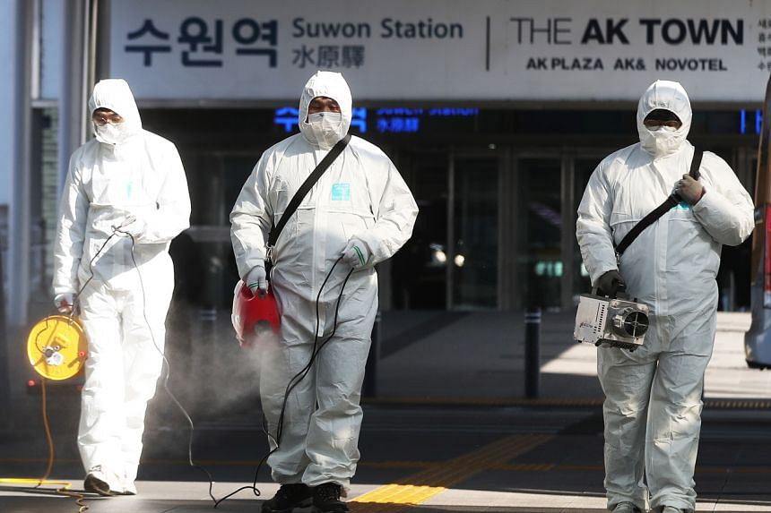 Quarantine officials disinfect at Suwon Station in Suwon, South Korea, on Feb 3, 2020.