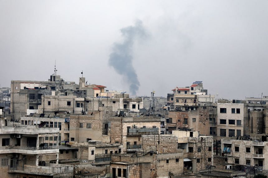 Smoke rises during government forces bombing on the village of Sarman, in Maarrat al-Nu'man district, Idlib, Syria, on Feb 4, 2020.