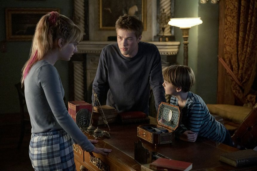 (From left) Emilia Jones, Connor Jessup and Jackson Robert Scott in Locke & Key. They play three siblings who move into their family's ancestral home, Keyhouse, after their father is murdered.