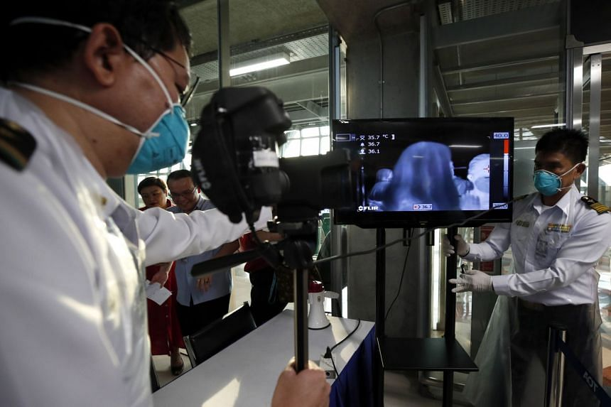 Thai health officials installing a thermal scanner at Suvarnabhumi Airport in Thailand on Jan 24, 2020.
