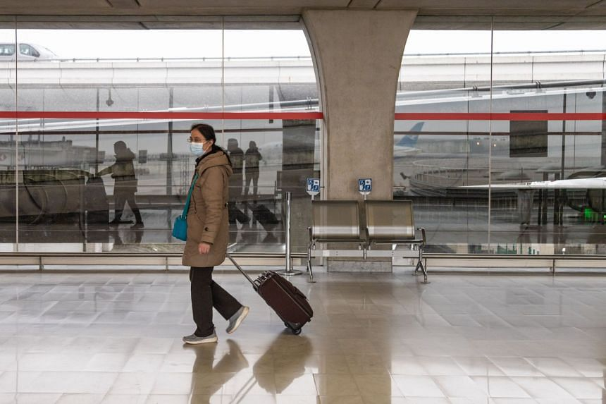 A traveller wearing a protective face mask at Charles de Gaulle airport in Roissy, France, on Jan 28, 2020. An anti-China slant, riding on the initial lack of transparency in alerting the world to the severity of the illness, may not be beneficial to