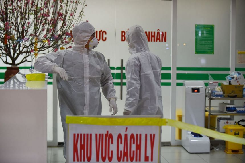 Medical workers in an isolation area at the National Hospital of Tropical Diseases in Hanoi on Jan 30, 2020.
