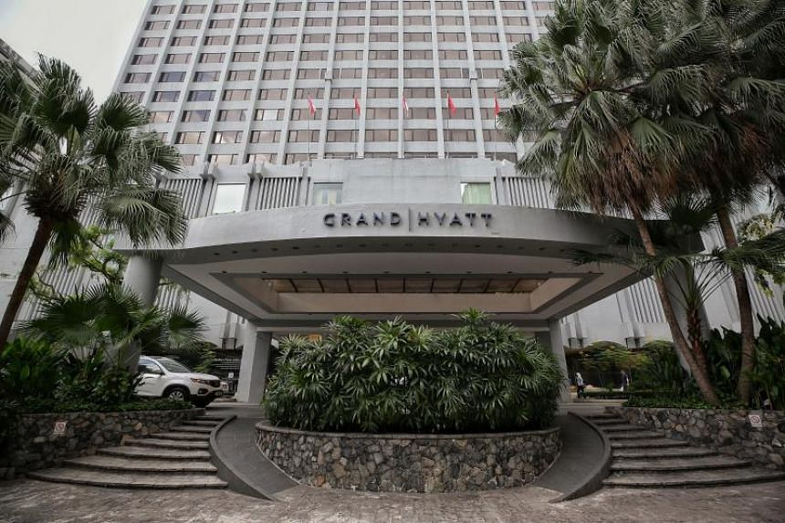The Grand Hyatt Singapore is disinfecting its public areas and rooms after two business travellers linked to a conference at the hotel tested positive for the coronavirus.