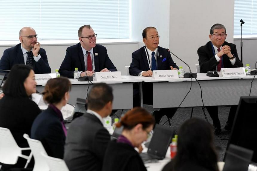 Tokyo Olympics chief executive Toshiro Muto (second from right) said he hoped the coronavirus outbreak in China would be quickly contained to restore confidence in the run-up to the Olympics.