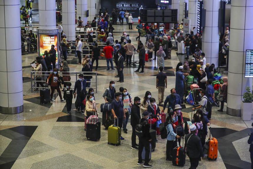Tourists walk through the Kuala Lumpur International Airport in Sepang, Malaysia, on Feb 4, 2020.