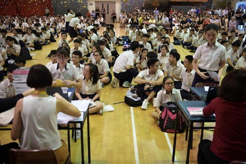 Students collect their O-level results at Xinmin Secondary School on Jan 13, 2020.