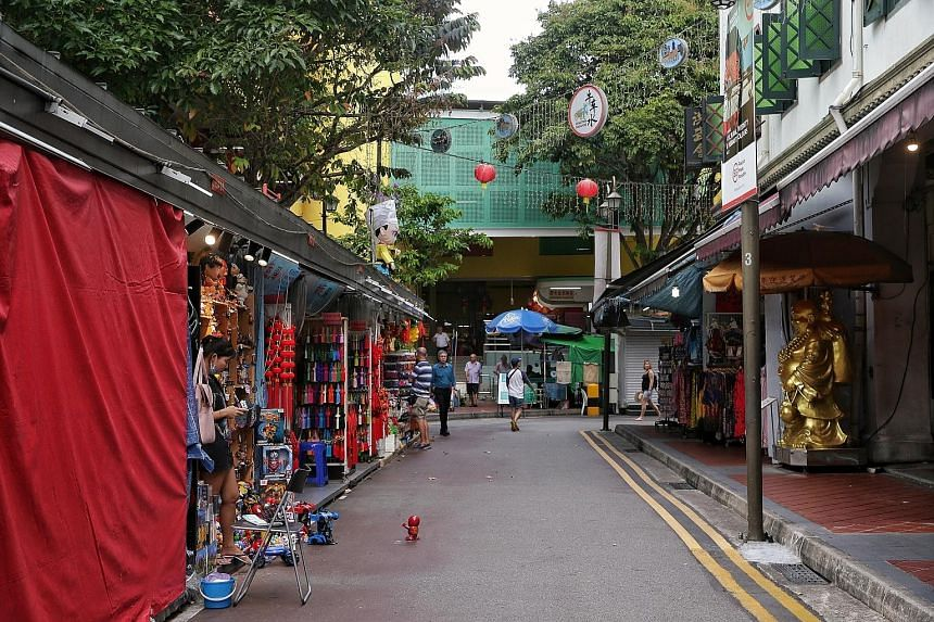 Sago Street in Chinatown was quieter than usual yesterday, as were other streets in the area. Some shop owners say they have seen a 50 per cent drop in sales and are bracing themselves for even worse times.