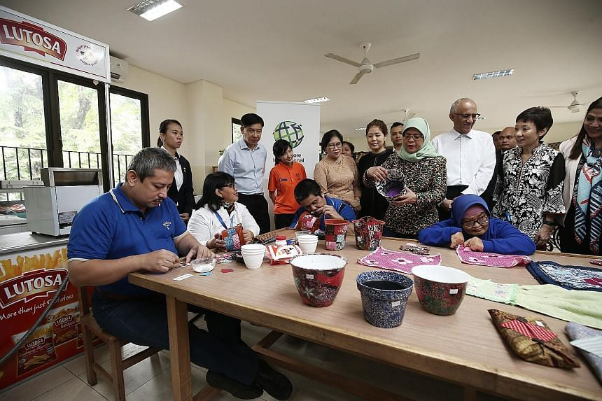 President Halimah Yacob at Singapore International Foundation's (SIF) occupational therapy session for those with special needs, in Jakarta, yesterday. With her were her husband Mohamed Abdullah Alhabshee; Minister for Culture, Community and Youth Gr