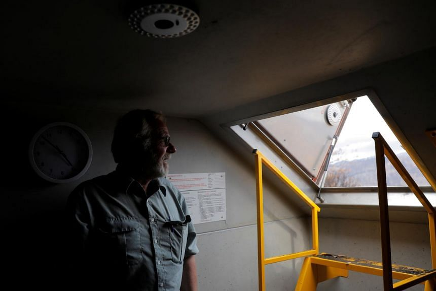 Cattle farmer Donald Graham poses in the bunker that he and his wife Bronwyn took shelter in as their home was destroyed by bush fires in Buchan, Victoria, Australia, on Jan 23, 2020.