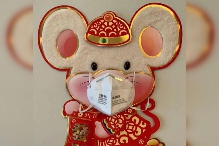 An image of a decorative rat donning a surgical mask went viral on Chinese social media.