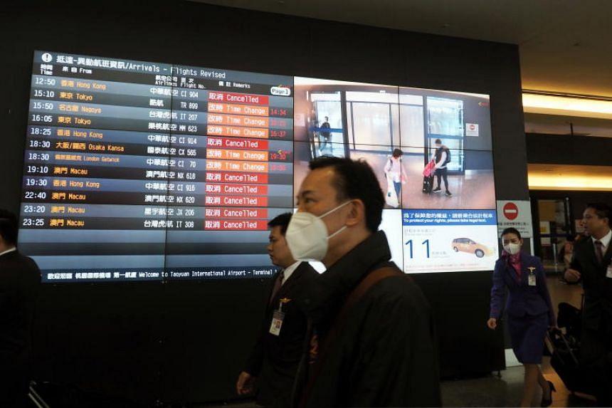 People arrive at the Taoyuan International Airport Taiwan, on Feb 4, 2020.